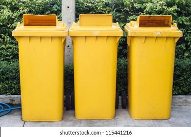 yellow garbage bins