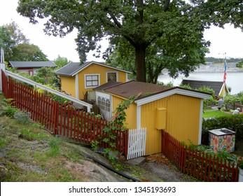 Yellow garden sheds