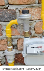 yellow gas pipe meter on the wall