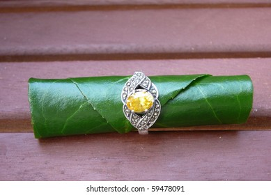 Yellow Gemstone Ring with Green Leaf