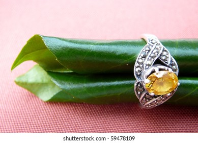 Yellow Gemstone Ring with Green Leaves