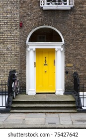 Yellow Georgian door in Dublin Ireland.