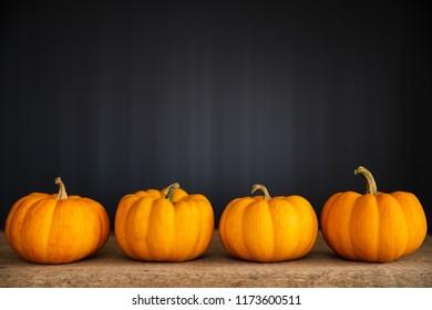 yellow ghost pumpkin on black background. halloween concept.