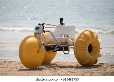 The yellow giant tricycle on the beach, Thailand.