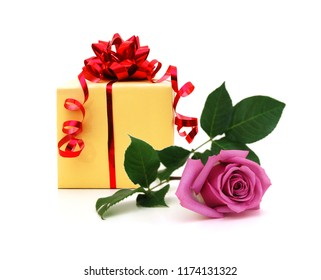 Yellow gift box with red gift ribbon and pink rose flower on white yellow