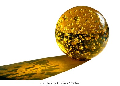 Yellow glass ball isolated on white background with shadow