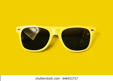Yellow glasses on a yellow background, sunglasses