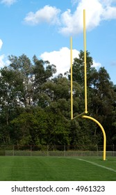 yellow goalposts for an American football game