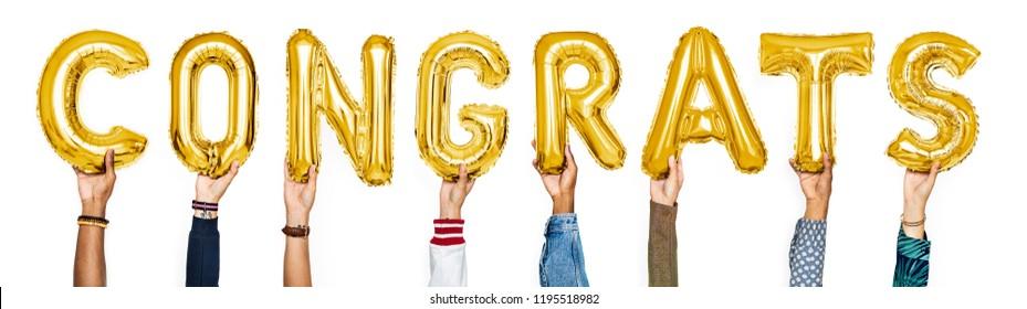 Yellow gold alphabet balloons forming the word congrats