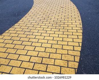 yellow or gold brick road asphalt