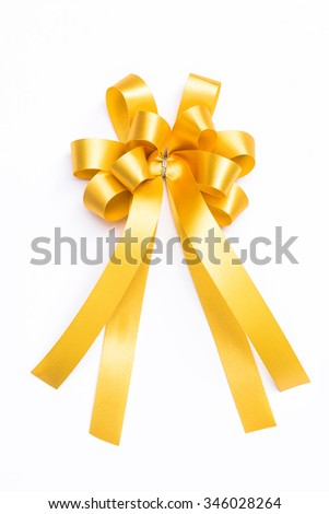 yellow gold color ribbon for christmas and new year gift decoration isolated on white background