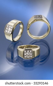 Yellow gold signet rings set with diamonds