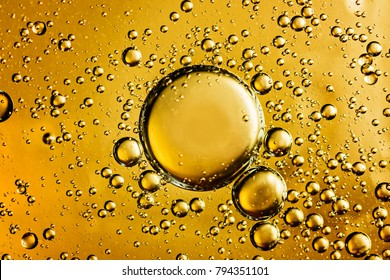 Yellow and golden  bubbles oil in water, abstract  background.