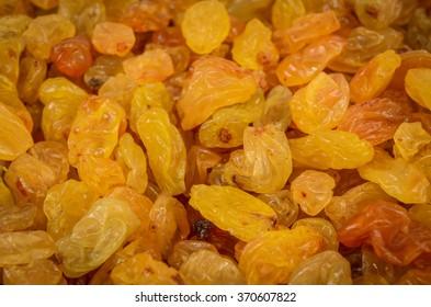 yellow golden raisins as background