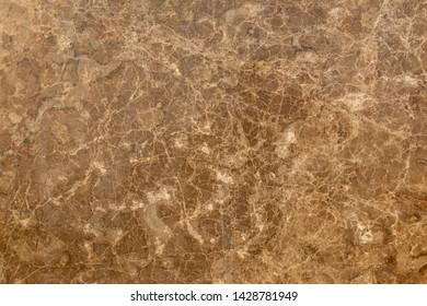 Yellow granite slab closeup background texture.