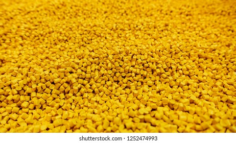 Yellow granules used in plastic industry.