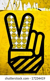 yellow graphic of hand peace symbol