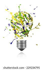Yellow green blue paint burst made conceptual light bulb