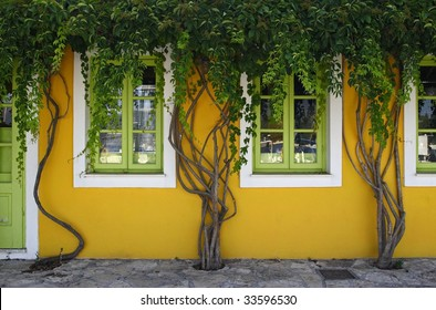 yellow green fasade in Fiscardo, Kefalonia, Greece