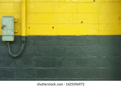 Yellow and green painted block wall