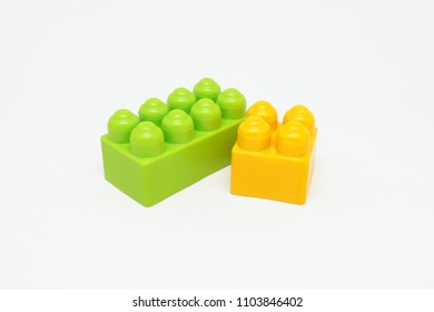 yellow and green plastic game blocks
