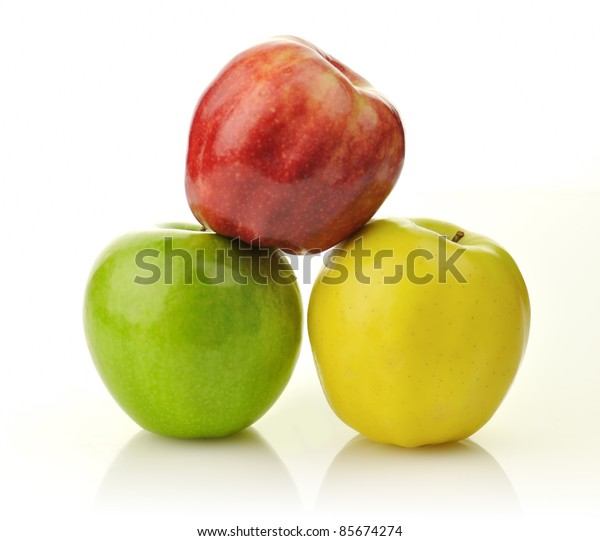 Yellow, green and red apples on white background