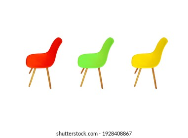 Yellow, green and red three bright plastic chairs isolated on white background, side view. Set of modern style empty seat in row for office job cut out
