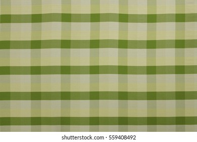 Yellow and green silk or cotton fabric with tartan or plaid style. It is lightweight and comfortable. This design typically can be found easily around Thailand.