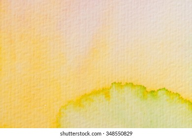 yellow and green watercolors on textured paper background