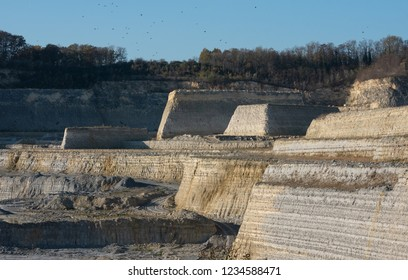 Yellow and grey marl quarry against a blue sky