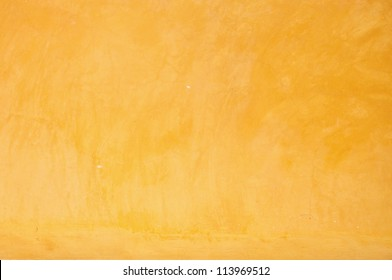 Yellow grunge cement wall, textured background