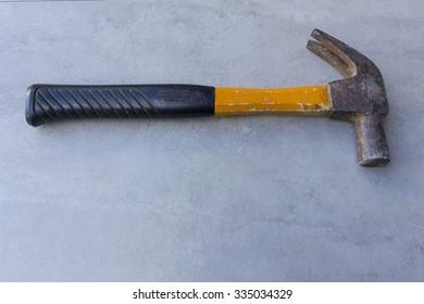yellow hammer on tile surface background