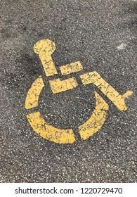 A yellow handicap parking spot.