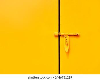 Yellow handle door lock for background