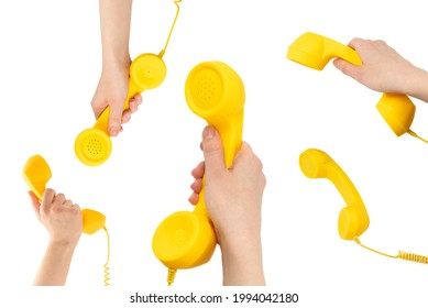 Yellow handset in woman hand isolated on white. Copy space.