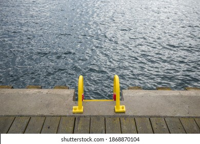 Yellow harbor ladder to the water
