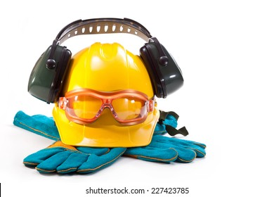 Yellow hard hat, earphones against noise, goggles and gloves on a white background