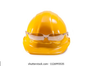 Yellow hard hat and glasses for work on a white background