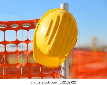 yellow hard hat on the road construction site and a safety net
