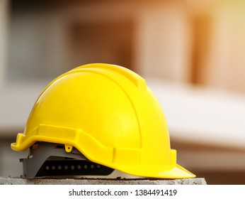 Yellow hard safety wear helmet hat in the project in construction site