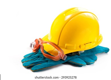 Yellow hardhat, goggles and gloves to work on a white background