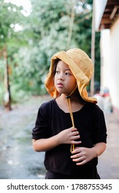 Yellow hat asian girl camping outdoor