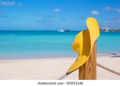 Yellow hat on the beach fence at caribbean island