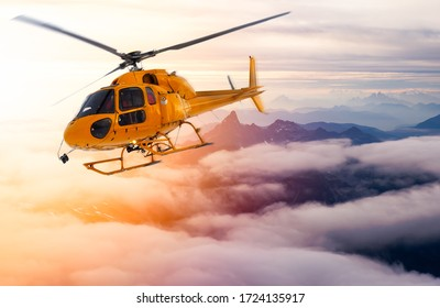 Yellow Helicopter flying over the Rocky Mountains during a sunny sunset. Aerial Landscape from British Columbia, Canada near Vancouver. Composite