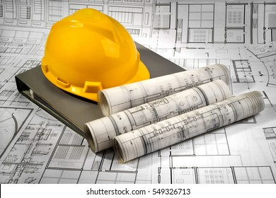 yellow helmet, grey folder and architectural project