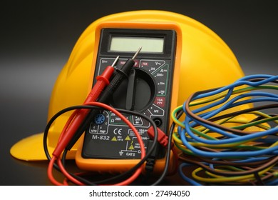 yellow helmet and multimeter