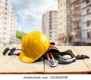 Yellow helmet on construction background