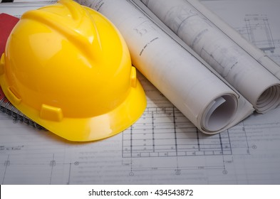Yellow helmet,  and project drawings