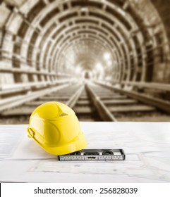 Is lying man railroad images stock photos vectors shutterstock yellow helmet for workers security bubble level and blueprint paper plan lie on table against background malvernweather Images