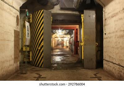 Yellow hermetic door in the underground tunnel